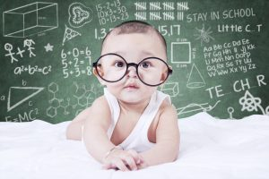 Funny baby with glasses and a doodles background
